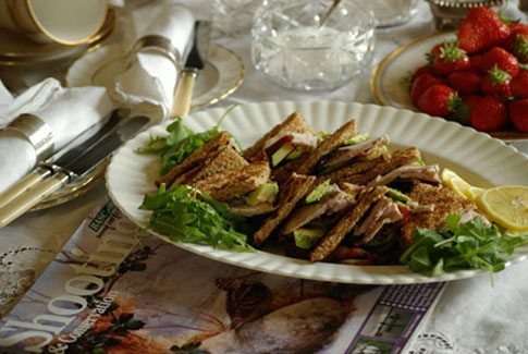 Pheasant, bacon and avocado toasted club sandwich