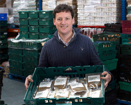 Chief Executive Tim Woodward gets the Country Casserole ready for distribution from FareShare in Bristol
