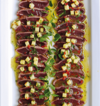 Sweet chilli glazed duck carpaccio with mango, lime and coriander Salsa.