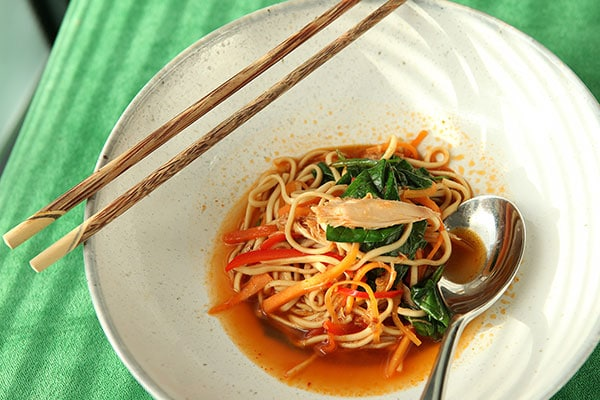 Korean spiced rabbit legs with rice noodles