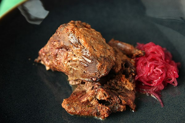 Tandoori pigeon with spiced onions
