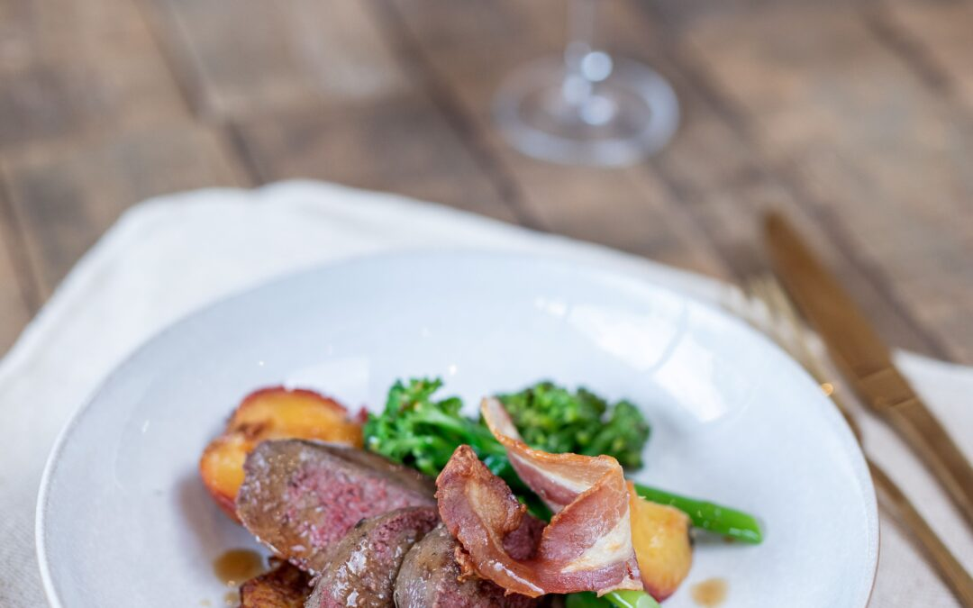 Grouse breasts with a potato rosti, roasted plums & bacon